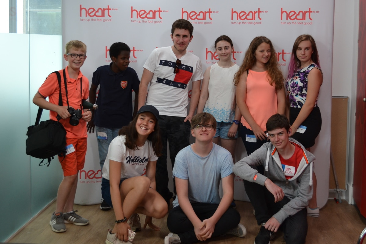Photo of Christopher Payne and other teenagers at Global radio studios